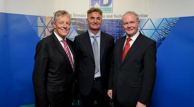 First Minister Peter Robinson with First Derivatives CEO Brian Conlon and Deputy First Minister Martin McGuinness at the opening of the company's North American headquarters in New York