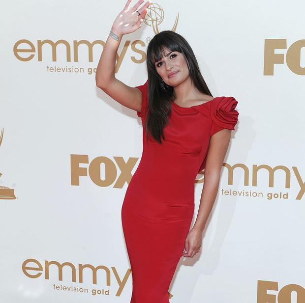 Lea Michele arrives at the Emmy Awards (AP)