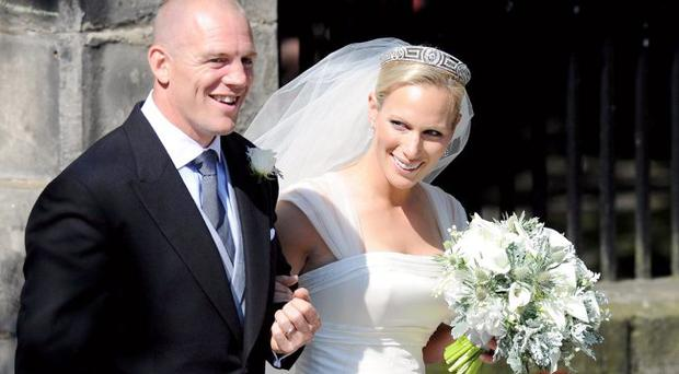 Beauty and the beast: Zara and Mike on their wedding day