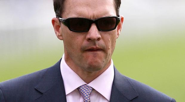 Racehorse trainer Aidan O'Brien has settled a bill for more than half a million euro in unpaid tax