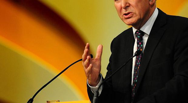Business Secretary Vince Cable addresses the Liberal Democrat annual conference at the ICC in Birmingham