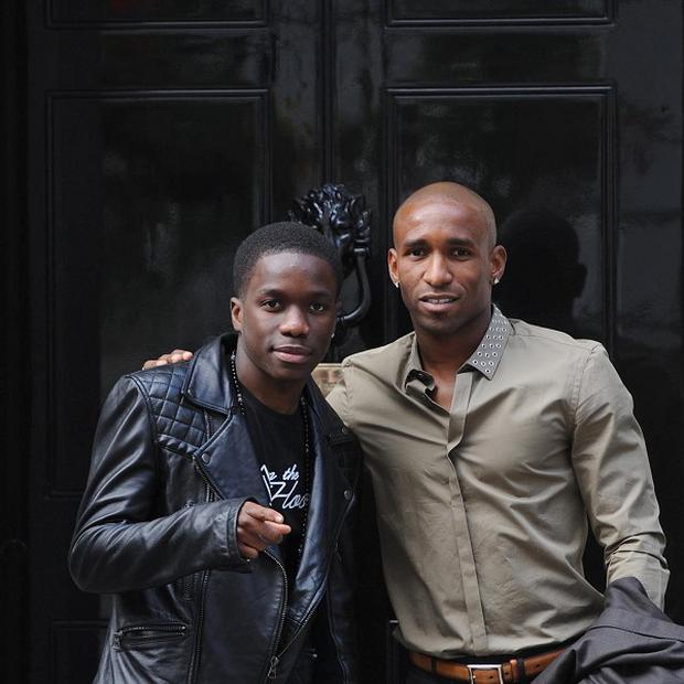 Recording artist Tinchy Stryder (left) and footballer Jermaine Defoe arrive at 10 Downing Street for the Spirit of London awards