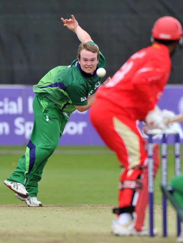 Paul Stirling bowls for Ireland as his side crush Canada in the first of two one-day internationals at Clontarf yesterday