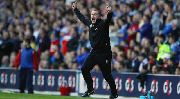 GLASGOW, SCOTLAND - SEPTEMBER 18: Neil Lennon coach of Celtic celebrates a goal during the Clydesdale Bank Premier League match between Rangers and Celtic at Ibrox Stadium on September 18, 2011 in Glasgow, Scotland. (Photo by Jeff J Mitchell/Getty Images)