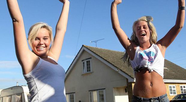 Travellers celebrate after hearing about the Court Order