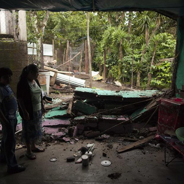 Residents examine their damaged house after an earthquake in Cuilapa, Guatemala (AP)
