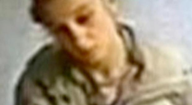 CCTV image of a woman, believed to be the mother of a newborn baby, leaving Newham General Hospital in east London