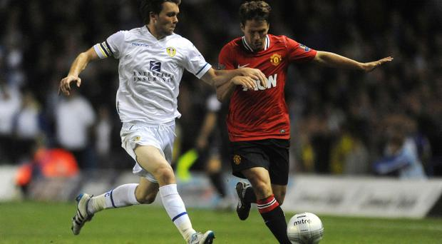 Leeds United's Jonathan Howson (left) and Manchester United's Michael Owen battle for the ball during the Carling Cup, Third Round match at Elland Road, Leeds