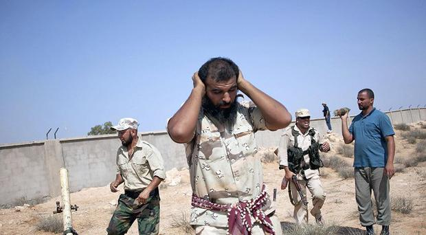 Revolutionary fighters have captured parts of the city of Sabha in southern Libya (AP)