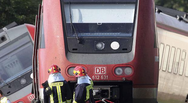 Firefighters at the scene after a train was derailed in Bad Lausick, near Leipzig, Germany (dapd)