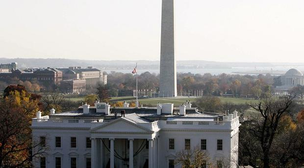 A man who climbed a fence and ran towards the White House has been detained