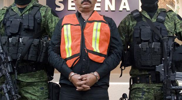 Saul Solis Solis, a key figure in the cult-like Knights Templar drug cartel, has been captured (AP)