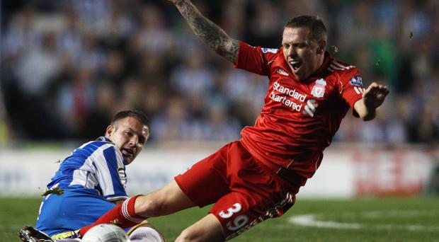 BRIGHTON, ENGLAND - SEPTEMBER 21: Alan Navarro of Brighton & Hove Albion tackles Craig Bellamy of Liverpool during the Carling Cup Third Round match between Brighton & Hove Albion and Liverpool at the American Express Community Stadium on September 21, 2011 in Brighton, England. (Photo by Clive Rose/Getty Images)