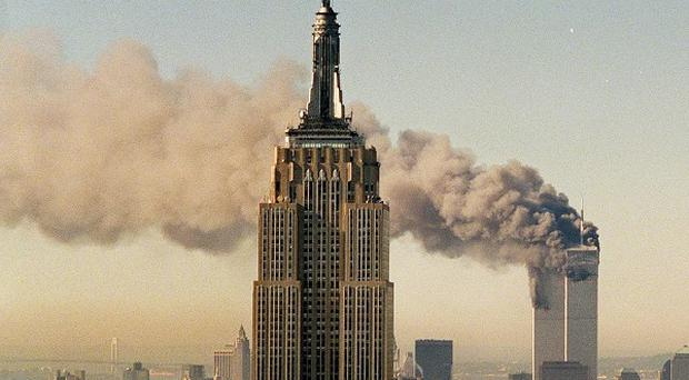 A scientist claims explosions triggered by molten aircraft metal reacting with water from sprinkler systems may have felled the Twin Towers (AP)