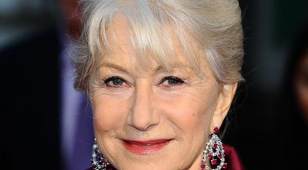 Helen Mirren arrives at the premiere of The Debt at the Curzon Mayfair cinema