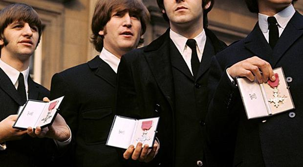 A 1965 Beatles concert contract, stating they would not play to a segregrated crowd has sold at auction