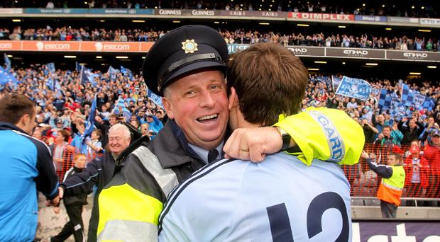 Former Dublin manager Paul Caffrey celebrates with captain Bryan Cullen