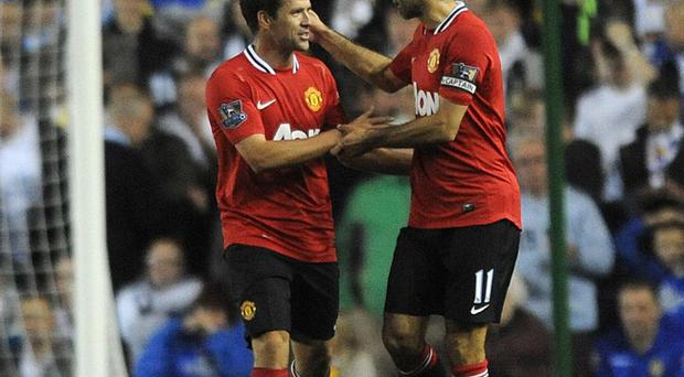 Manchester United's Michael Owen celebrates with Ryan Giggs (right) after scoring his side's second goal during the Carling Cup, Third Round match at Elland Road, Leeds