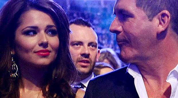 TV critics have questioned Simon Cowell's decision to axe Cheryl Cole from the US X Factor