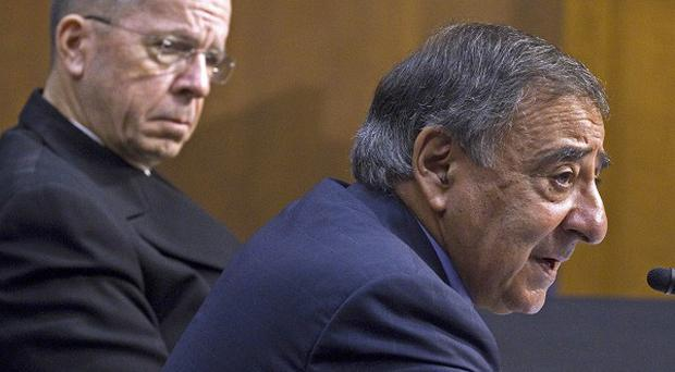 Defence secretary Leon Panetta, right, and Joint Chiefs Chairman Admiral Michael Mullen testify before a Senate committee (AP)