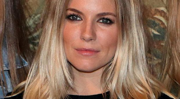 Sienna Miller said she blamed her family for leaks of private information to a newspaper that was hacking her phone