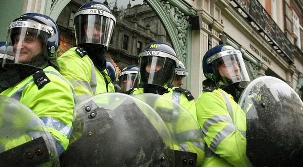 Scotland Yard should not be given any additional national policing functions, a report by MPs has said