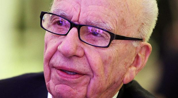 Rupert Murdoch's News Corp is to face legal action in the US over phone hacking