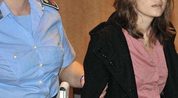 Amanda Knox, right, escorted by a guard, arrives at the courthouse for the appeal trial in Perugia (AP)