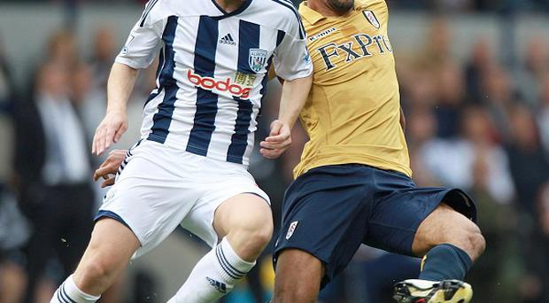 Graham Dorrans (left) and Moussa Dembele (right)