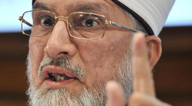 Dr Muhammad Tahir-ul-Qadri was applauded during a speech in which he said the 'terrible' 9/11 attacks had distorted perceptions of Islam