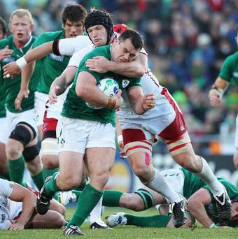 Cian Healy of Ireland is tackled by Andrey Garbuzov of Russia during the IRB 2011 Rugby World Cup Pool C match between Ireland and Russia at Rotorua International Stadium on September 25, 2011