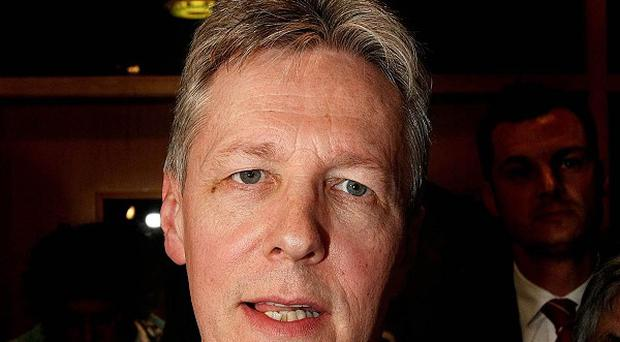 First Minister Peter Robinson has welcomed an agreement to reduce the number of local councils to 11