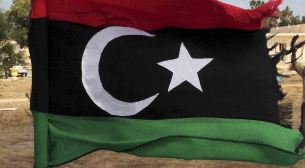 A mass grave containing the remains of 1,270 inmates killed by the regime of former Libyan leader Muammar Gaddafi has been uncovered (AP)