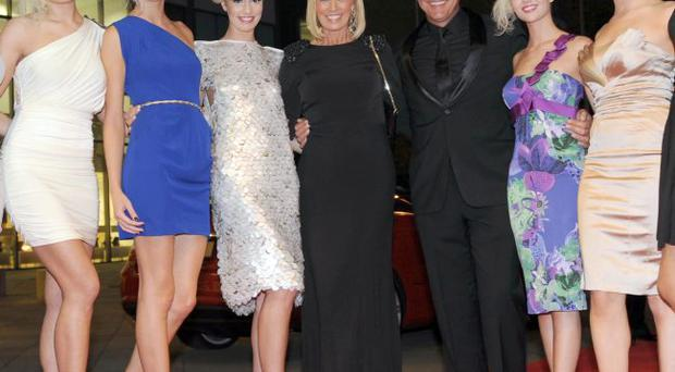 British Open champion Darren Clarke was all smiles as he arrived on the red carpet with his fiancee Alison Campbell and line up of models at Ulster Tatler People of the Year Awards at the Waterfront Hall