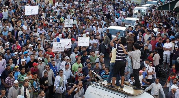 Anti-government protesters during a rally in Casablanca, Morocco