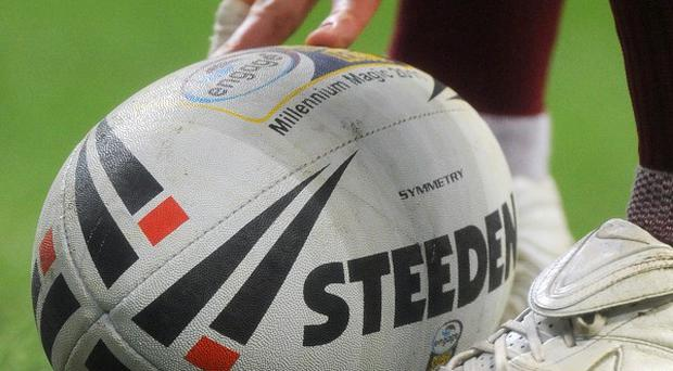 A combined Garda and PSNI team is to play rugby under a new emblem made up of the Garda and PSNI crests