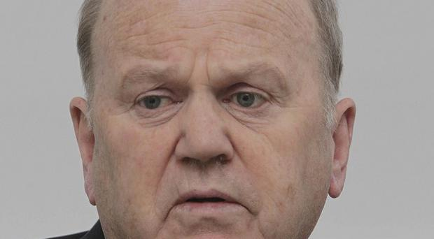 Michael Noonan is examining AIB's request to appoint a chief executive with a salary of more than 500,000 euro