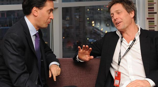 Labour leader Ed Miliband meets with actor Hugh Grant at the Labour Party conference in Liverpool