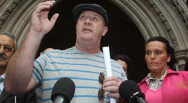 Dale Farm travellers speak to the media outside the Royal Courts of Justice in London