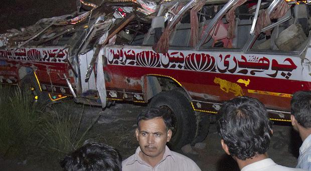 A damaged bus at the site of an accident in Kalar Kahar, Pakistan (AP)