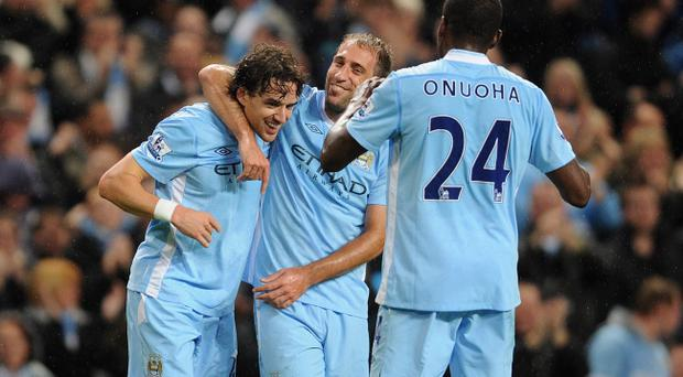 Back in action: Owen Hargreaves (left) made a goalscoring return last week, but now in the blue of his former club's rivals, Manchester City