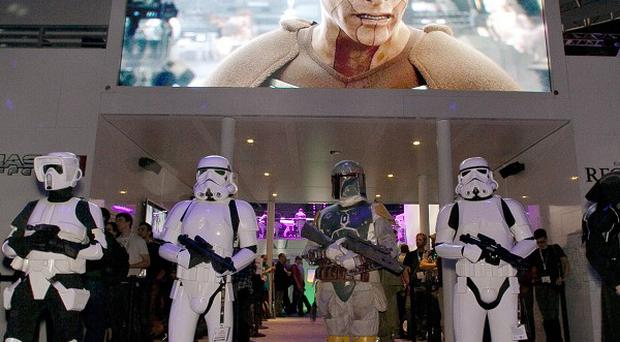 Star Wars characters introduce Star Wars The Old Republic game, from Bioware, which is to establish a customer service centre near Galway (AP)