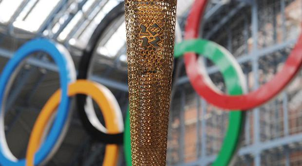 Discussions are being held into whether the Olympic torch (pictured here in St Pancras Station, London) can be brought to Dublin