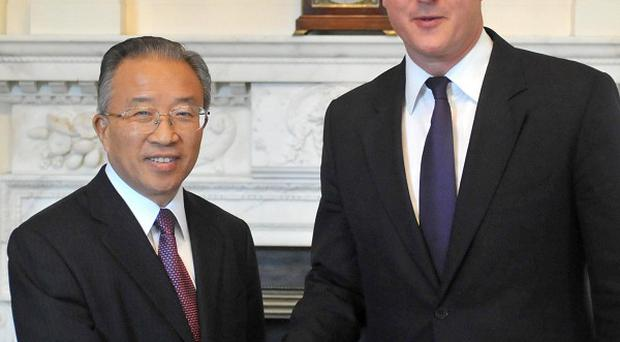 Prime Minister David Cameron greets Chinese State Councillor Dai Bingguo at 10 Downing Street