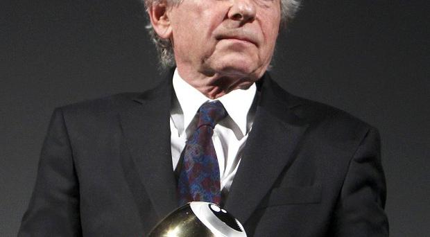 Roman Polanski picks up the award for his life work at the Film Festival in Zurich, Swzitzerland (AP)