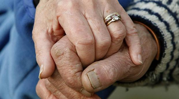 A devoted husband suffocated his partner, who had Alzheimer's, before drowning himself in a lake