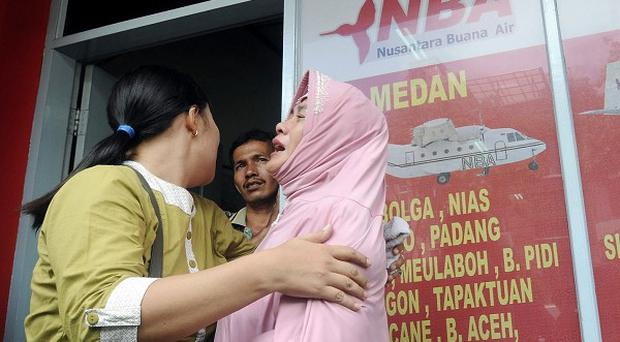A relative of a victim cries at the airliner's office in Medan, North Sumatra (AP)