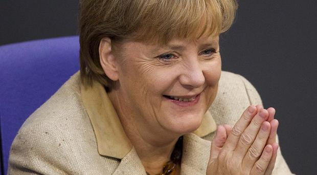 German Chancellor Angela Merkel's right-wing coalition has voted in favour of expanding the capacity of the eurozone bailout fund