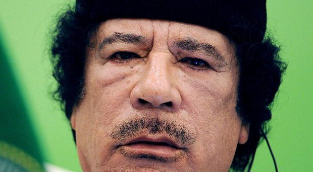 Interpol has issued a red notice for another of Muammar Gaddafi's sons (AP)