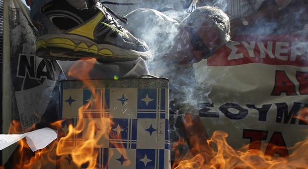 Pensioners burn emergency tax notices in Athens (AP)